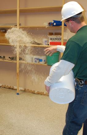 Cornerstone Flooring installer spreading aggregate for skid resistance